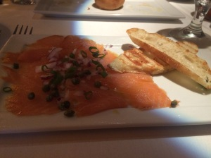 Bay of Fundy Smoked Salmon with capers, pickled red onions, and lemon - divine!